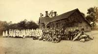 Children and teachers outside Ockham village school, late 19th century