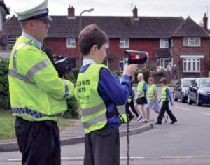 Man and child with speed gun