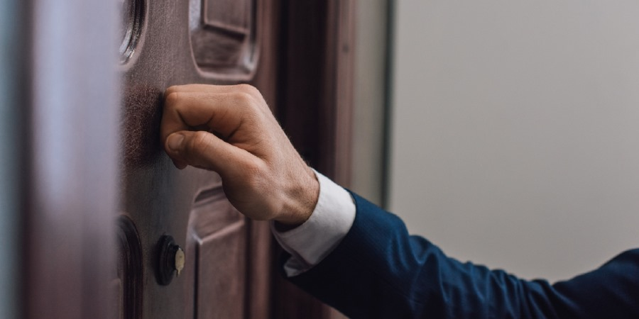 Person knocking on a door