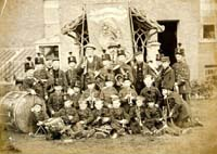In common with other schools and similar institutions at the time, Byfleet Industrial School had its resident band.  The band members, posed with their instruments, are in front of the school buildings, facing onto Parvis Road