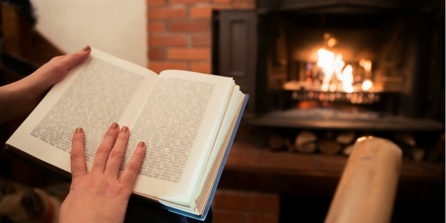 Book reading by fire