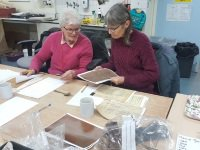 Volunteers carrying out research on John Baxter