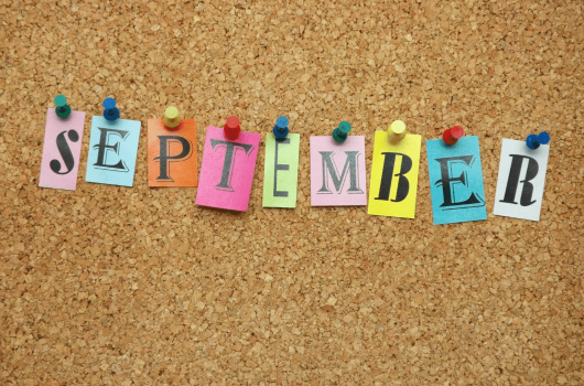 Pin board with September pinned to it