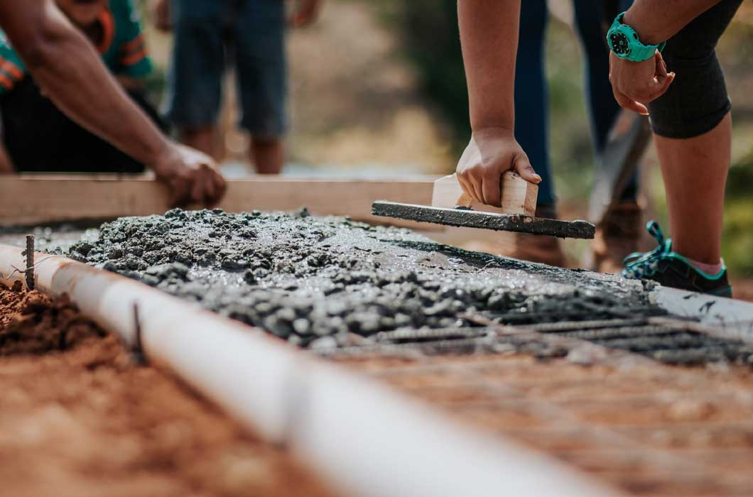People laying concrete foundations
