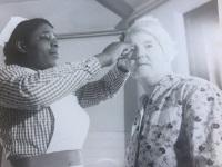 Black nurse treating a patient at Netherne Hospital c1955