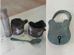 A spoon, two cups and a jar, excavated and awaiting a clean
