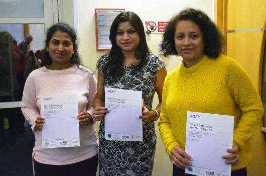 Three women holding certificates