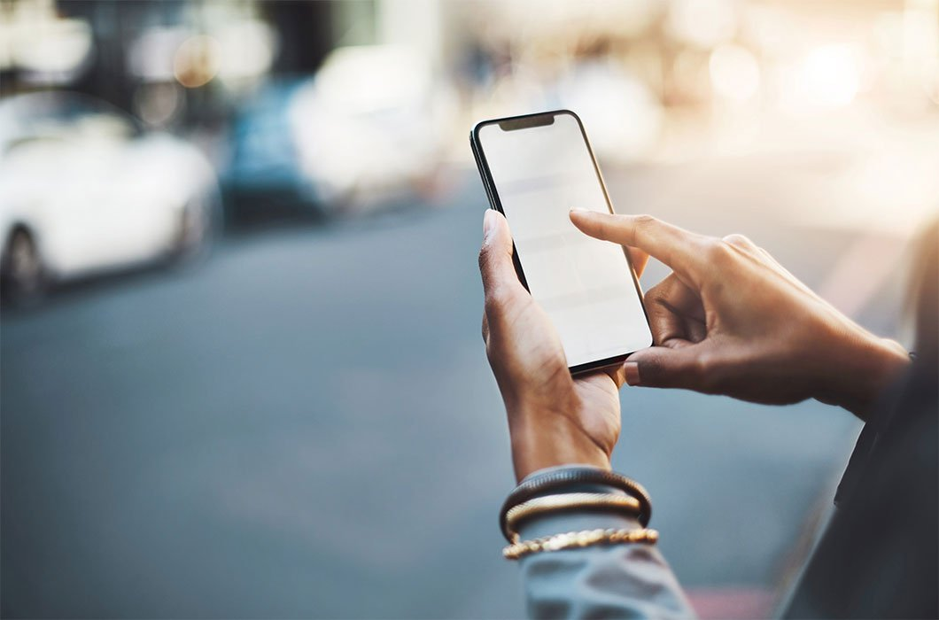 Image of person using mobile phone