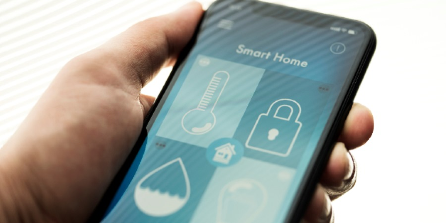 Person holding a smart phone with an app called smart home open on the screen