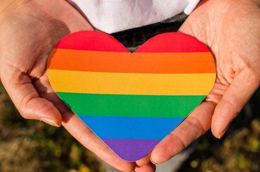 image of rainbow heart in hands