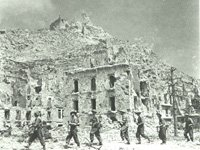 Soldiers of 1/6th Battalion, the East Surrey Regiment in the ruins of Cassino, 1944. (SHC ref ESR/10/12/1)