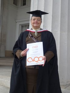 Susanne, wearing her robes after achieving her CVQO qualification