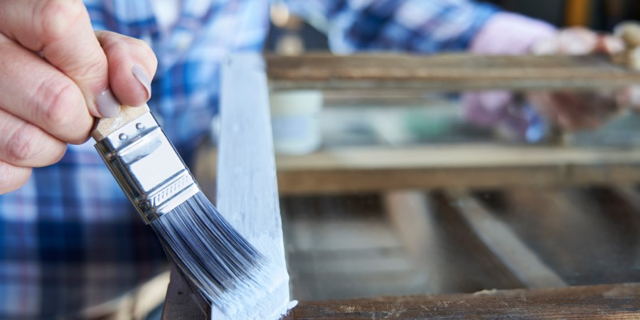 Hand painting a wooden frame