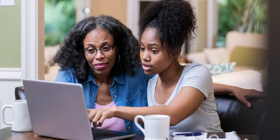 Image of woman and daughter looking at laptop