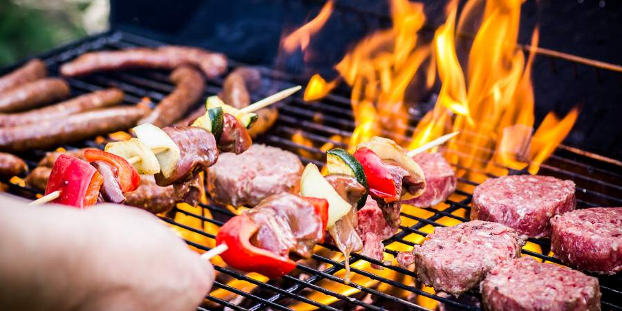 Image of person cooking food on a barbeque