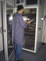 Operative using blast freezer at Surrey History Centre