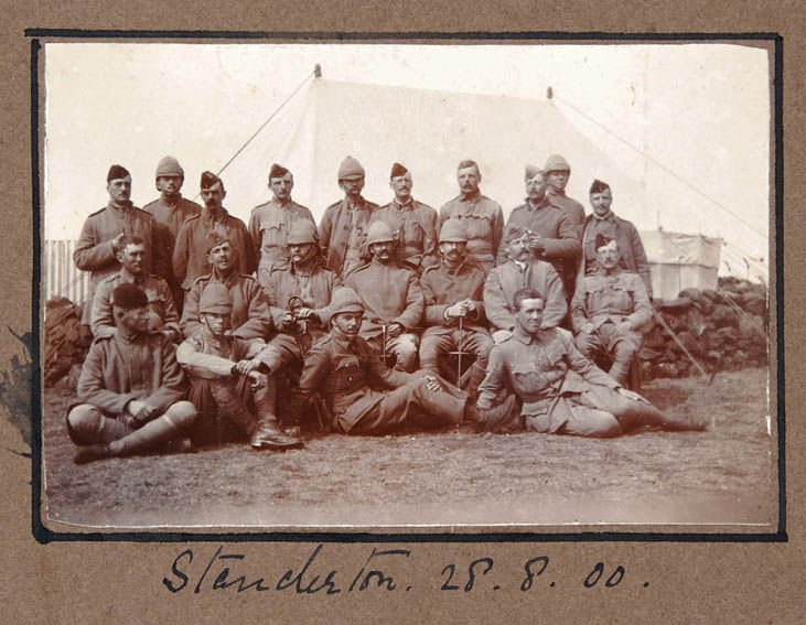 Group photograph, in various styles of service dress, taken in camp in August 1900. SHC ref QRWS/3/11/14/2