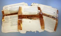 BEFORE: Well-intentioned home repairs done with glue and adhesive tape can discolour paper or cause portions to of text to disappear whilst over use or mishandling can make items disintegrate completely