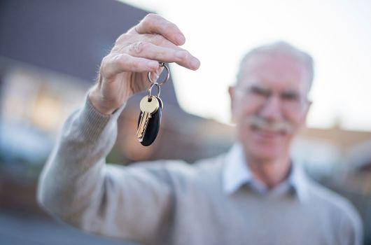 Grey man with keys