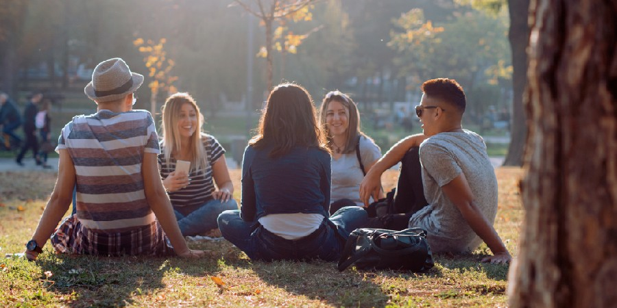 Image of people sitting outside together