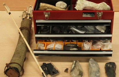 Box containing prehistoric tools and weapons made of flint, bone and wood