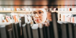 Woman in library looking at books