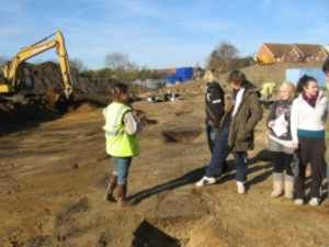 Local residents visiting the site during excavations at St. Ann's Heath Primary School