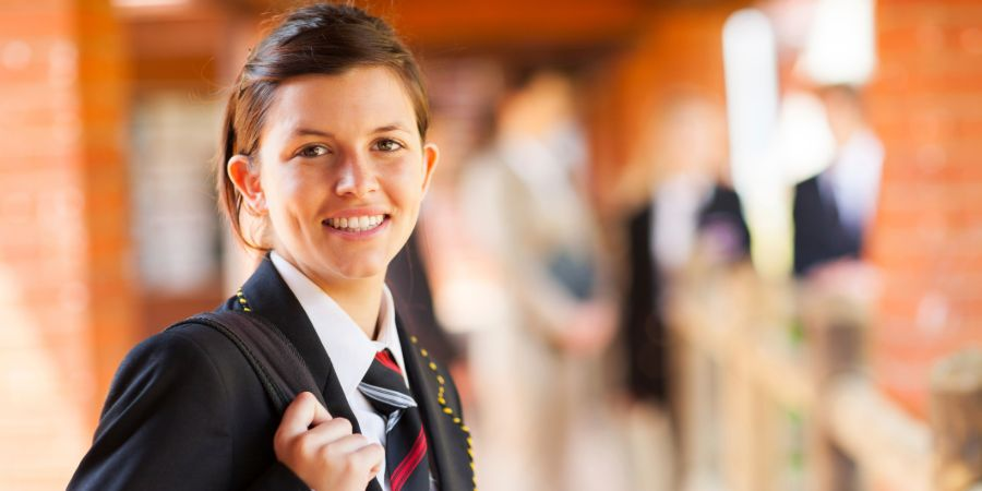 Schoolgirl smiling at camera
