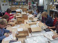 Volunteers re-packaging finds from the Oatlands Palace archive Jan 2020
