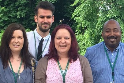 A group of five adult social care staff