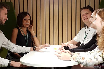 People sitting around a table chatting