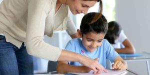 Teacher helps child with work