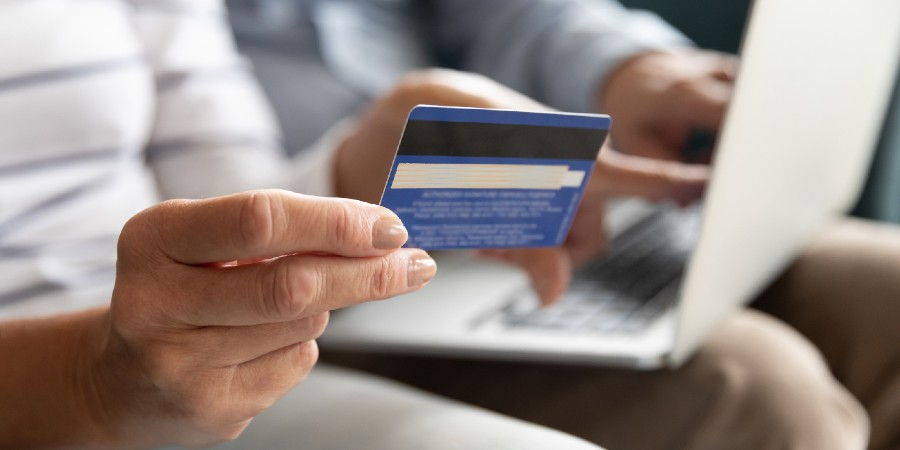 Image of person holding credit card