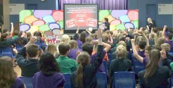 Children watching a presentation