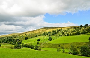Scenic view across hills and fields